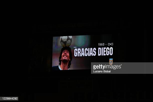 Giant screen displays an image in memory of Diego Maradona before the minute of silence before a match between Rosario Central and River Plate as...