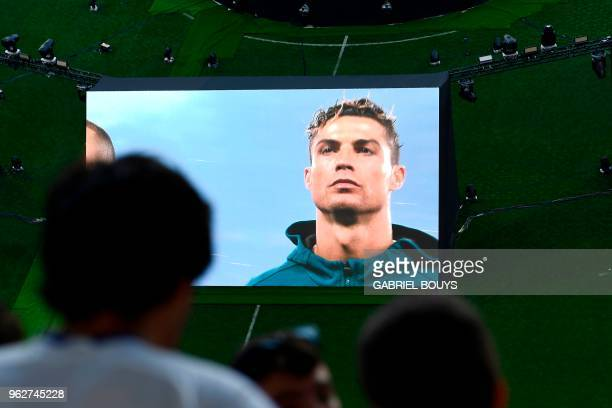A giant screen displays Real Madrid's Portuguese forward Cristiano Ronaldo at the Santiago Bernabeu stadium before the projection on giant screens of...