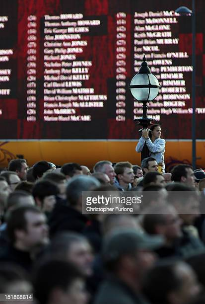 A giant screen displays the nakes of the victims of the Hillsborough disaster during a vigil outside Liverpool's St George's Hall after the...