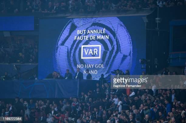 Giant screen show the VAR decision during the UEFA Champions League Group A match between Paris Saint Germain and Real Madrid at Parc des Princes on...
