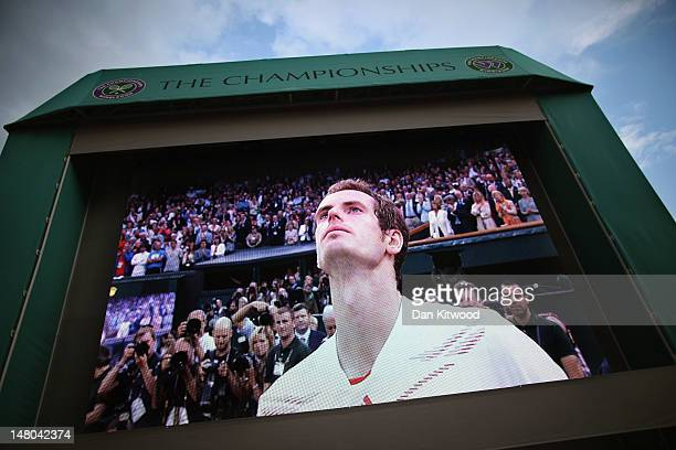 A giant screen shows Andy Murray as he speaks after losing his Gentlemen's Singles final match against Roger Federer on day thirteen of the Wimbledon...