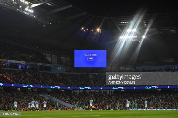 A giant screen shows the words VAR as Turkish referee Cuneyt Cakir checks the VAR system before confiming Tottenham Hotspur's Spanish striker...