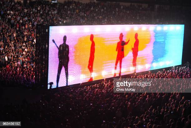 Giant screens project images throughout U2's performance during the eXPERIENCE iNNOCENCE TOUR at Infinite Energy Arena in Duluth GA