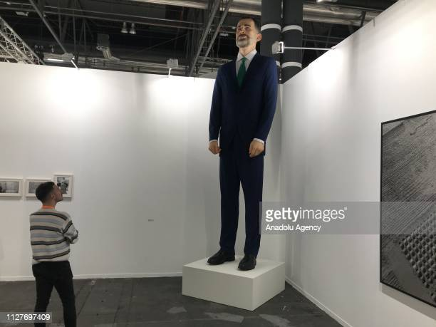 Giant sculpture depicting Spain's King Felipe VI by artists Santiago Sierra and Eugenio Merino is on sale to which his buyer must light after paying...