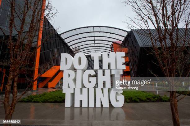 "Giant sculpture reads ""Do the right thing,"" at the Nike headquarters on March 22, 2018 in Beaverton, Oregon. Nike, the world's largest sports brand,..."