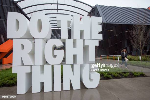 A giant sculpture reads Do the right thing at the Nike headquarters on March 22 2018 in Beaverton Oregon Nike the world's largest sports brand...