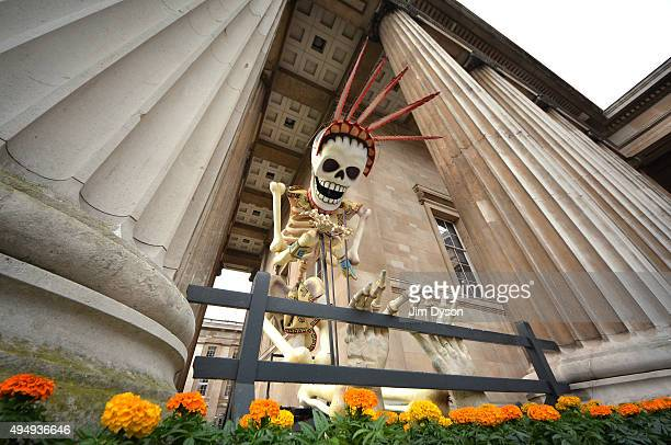 A giant skeleton film prop from the new James Bond film Spectre is displayed at the British Museum for the 'Days of the Dead' Festival on October 30...