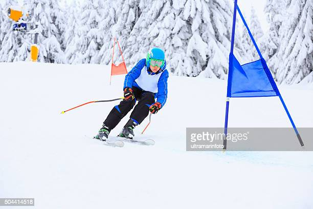 giant slalom race  a young boy teenager  snow skier skiing - ski racing stock pictures, royalty-free photos & images
