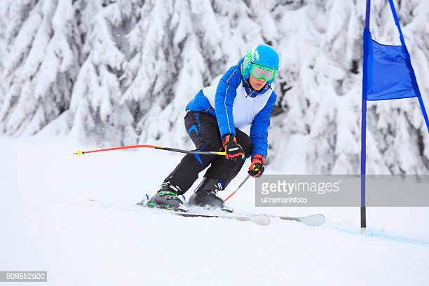 Giant slalom race  A young boy teenager  snow skier skiing