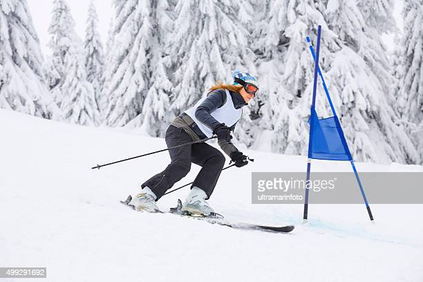 giant slalom race  women  snow skier skiing - ski racing stock pictures, royalty-free photos & images