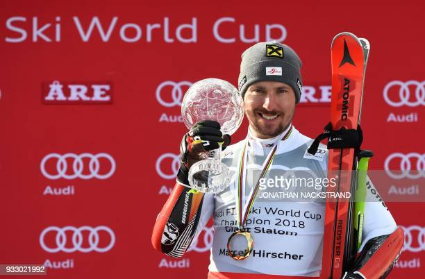 Giant Slalom World Cup overall winner Marcel Hirscher of Austria poses on the podium after the Men's Giant Slalom event of the Alpine Skiing World...