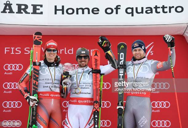 Giant Slalom World Cup overall winners Henrik Kristoffersen of Norway Marcel Hirscher of Austria and Alexis Pinturault of France pose on the podium...