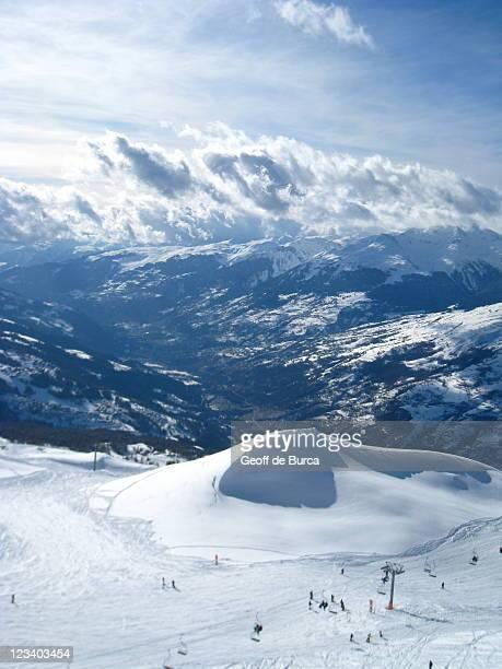 Giant snowdrift rising over valley