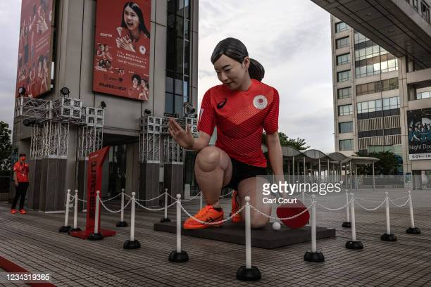 Giant statue of Japanese Olympic table-tennis player Kasumi Ishikawa is displayed outside the Fuji TV headquarters on July 30, 2021 in Tokyo, Japan....