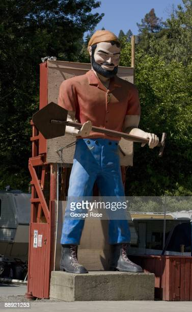 A giant statue of Paul Bunyan stands guard at a forest mobile home park in this 2009 Guerneville California summer morning photo