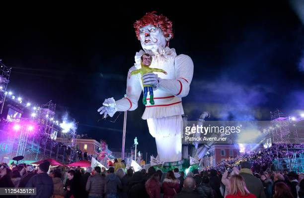 A giant statue of US President Donald Trump depicted as an evil clown holding a French President Emmanuel Macron's puppet in his hand parade during...