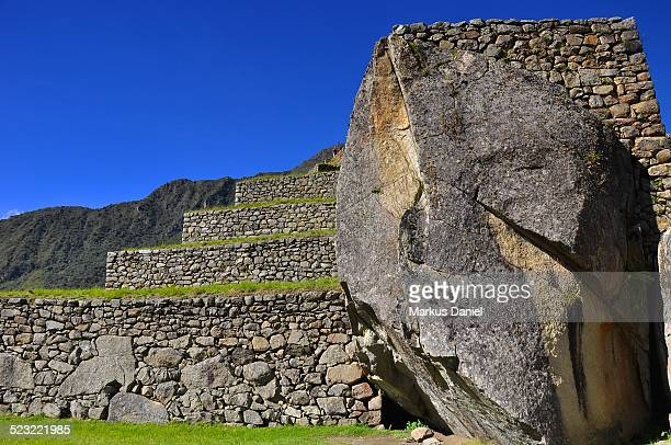 """giant stone boulders with terraces in machu picchu - """"markus daniel"""" stock pictures, royalty-free photos & images"""