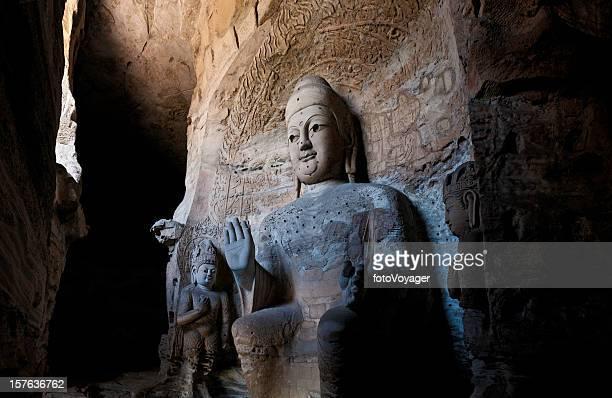 Giant stone buddha caves Yungang Grottoes temple Datong Shanxi China