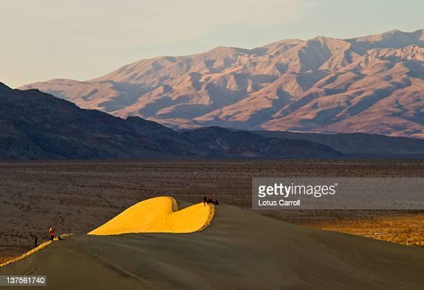 Giant sunlit heart shape in sand dunes