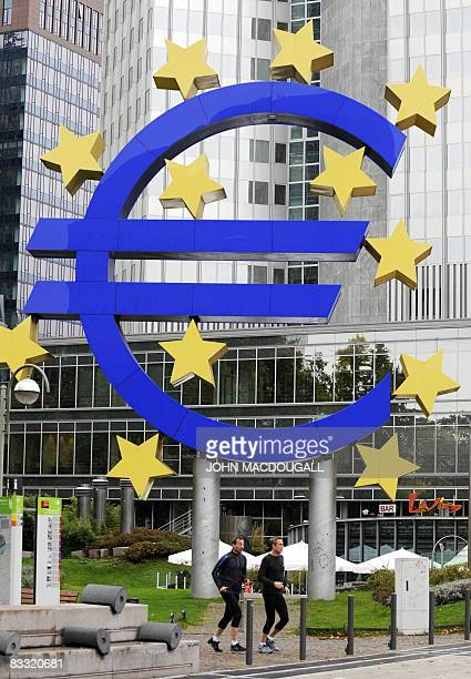 A giant symbol of the European Union's currency the Euro stands outside the headquarters of the European Central Bank in Frankfurt on October 16 2008...