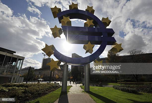 A giant symbol of the European Union's currency the Euro stands outside the headquarters of the European Central Bank in Frankfurt on October 17 2008...