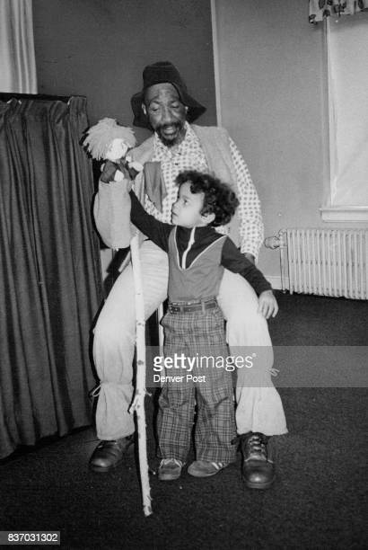 APR 13 1979 APR 18 1979 'Giant' Talks over puppet show with fan William 'Booley' Kelley Montview Community Preshcool parent talks about 'Jack and the...