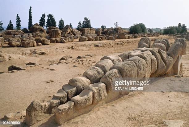 Giant telamon lying on the ground from the Temple of Jupiter Valley of the Temples of Agrigento Sicily Italy Magna Graecia civilization 6th5th...