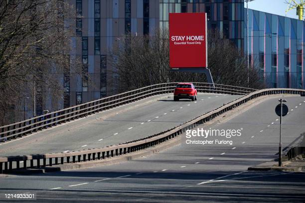 Giant television over the A57 Motorway screen urges people to stay home on March 26, 2020 in Manchester, England. British Prime Minister, Boris...