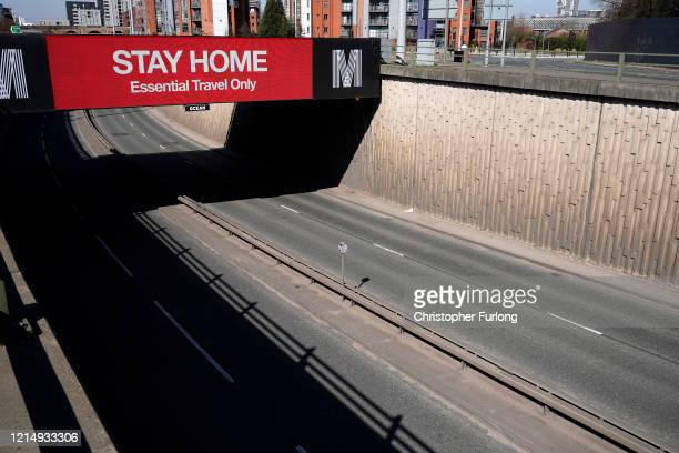A giant television over the A57 Motorway screen urges people to stay home on March 26 2020 in Manchester England British Prime Minister Boris Johnson...