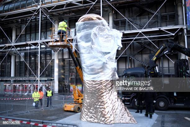 Giant thumb sculpture by French artist Cesar Baldaccini known as Cesar, is installed outside the Centre Pompidou art centre in Paris on November 28...