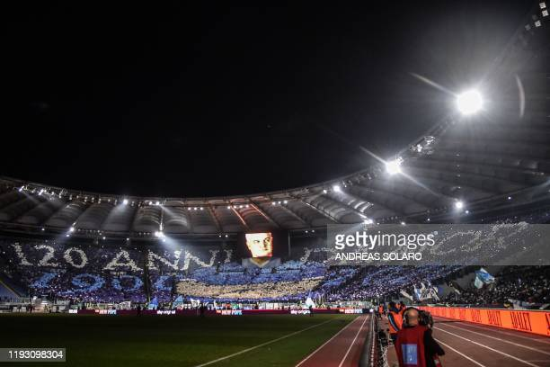 """Giant tifo reading """"120 Years of Love - 1900 - 2020"""", refering to Lazio's foundation in 1900, is displayed by supporters prior to the Italian serie A..."""