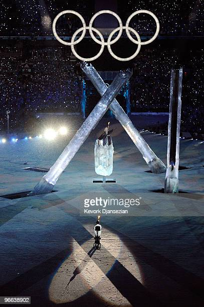 Giant torches come out of the ground prior to being lit with the Olympuic flame during the Opening Ceremony of the 2010 Vancouver Winter Olympics at...