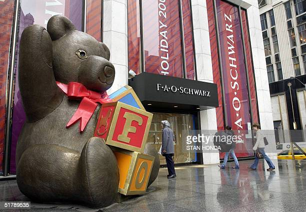 A giant toy bear sits outside the entrance to the upscale US toy retailer FAO Schwarz 24 November in New York This landmark Manhattan store will...