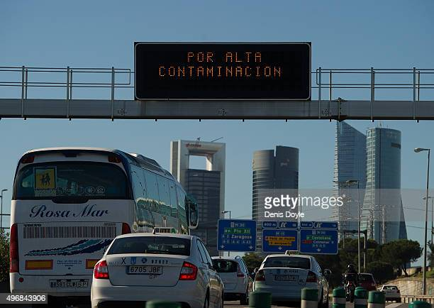 A giant traffic sign reads ''Because of high Pollution Levels'' after Madrid City Council reduced the speed limit on roads approaching and around the...