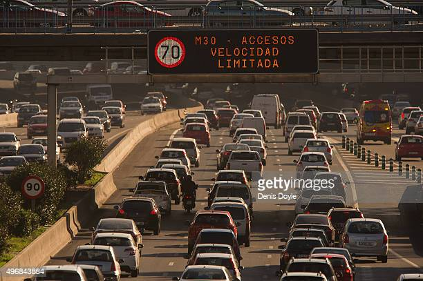 A giant traffic sign reads ''M30 Speed Limited to 70km/h after Madrid City Council reduced the speed limit on roads approaching and around the...