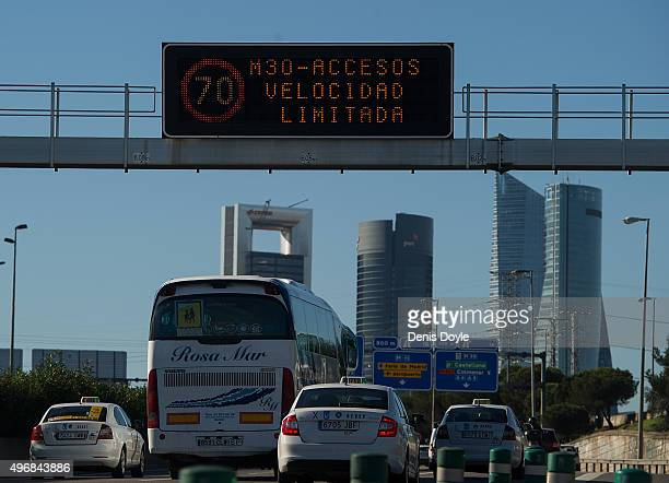 A giant traffic sign reads ''M30 Turnoff Speed Limited to 70km/h after Madrid City Council reduced the speed limit on roads approaching and around...