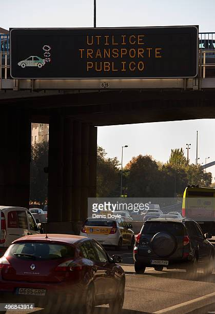 A giant traffic sign reads ''Use Public Transport'' after Madrid City Council reduced the speed limit on roads approaching and around the Spanish...