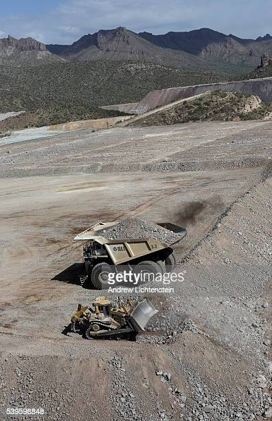 Giant trucks haul crushed rock from various points throuh the Ray Mine The small mining communities of Kearny and Hayden Arizona are in the heart of...