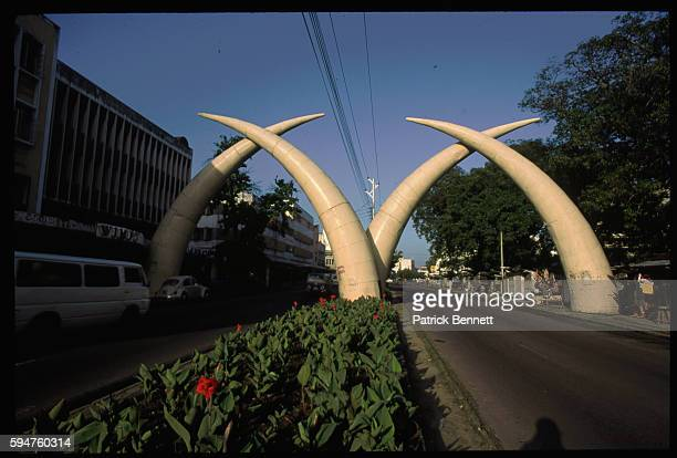 Giant Tusks Arch Over a City Street