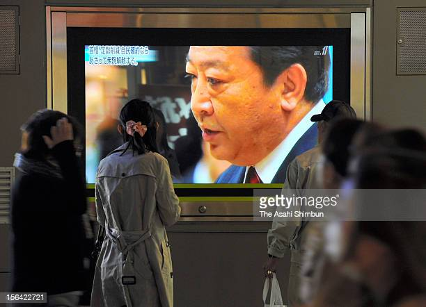 A giant TV screen on the street reporting about Japanese Prime Minister Noda's remark during oneonone debate with Liberal Democratic Party chief...
