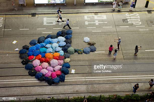 A giant umbrella made of umbrellas adorn the pavement in the 'Occupy Central' camp of Causeway Bay on October 13 2014 in Hong Kong A third week of...