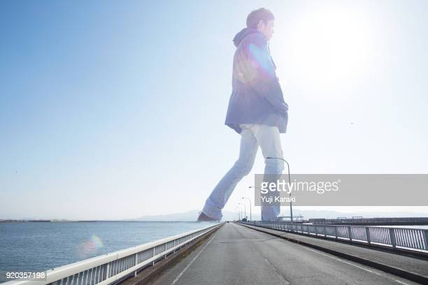 giant walking through the sea - giants stock photos and pictures