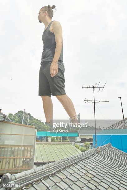 giant walking through the urban areas - giants stock photos and pictures
