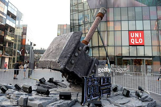 """Giant warhammer """"hits"""" at the Sanlitun Square at Beijing Sanlitun on May 30, 2016 in Bejing, China. World of Warcraft and Intel held the campaign as..."""