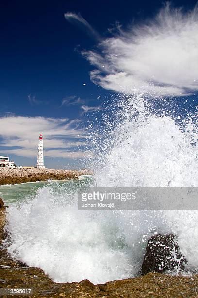 Giant wave and lighthouse, Ilha do Farol, Portugal