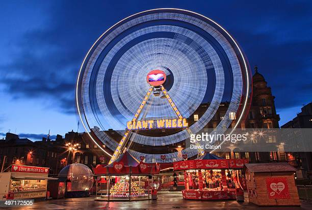 CONTENT] A giant wheel rotates at dust during the Love Town celebrations at George Square Glasgow