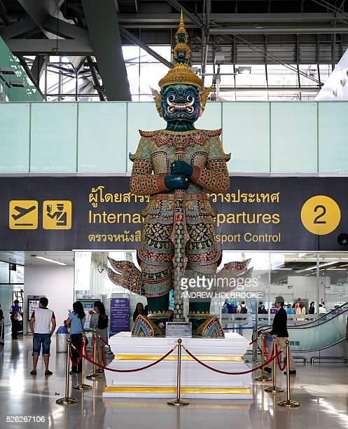 A giant Yaksha statue stands guard in Bangkok's International Suvarnabhumi Airport