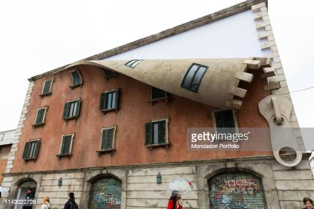 A giant zip turns the Spazio 400 into the Tortona Rocks circuit in a surreal installation The work is signed by the British artist Alex Chinneck for...