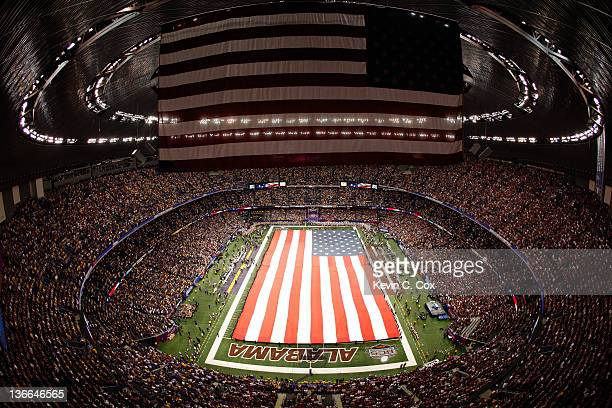 Giants American Flag is displayed on the field prior to the 2012 Allstate BCS National Championship Game between the Louisiana State University...