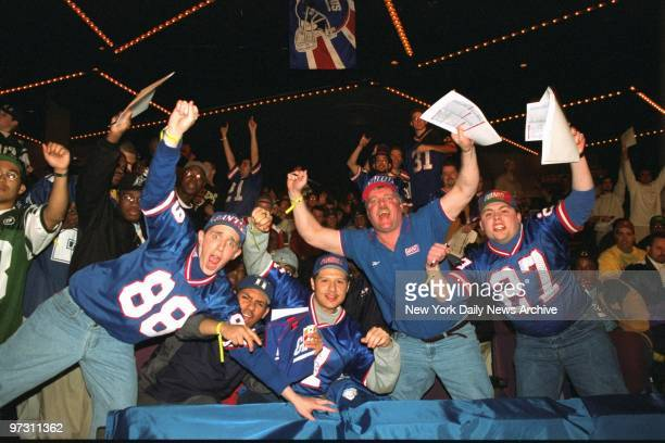 Giants and Jets fans make their wishes known at the NFL draft in the theater at Madison Square Garden